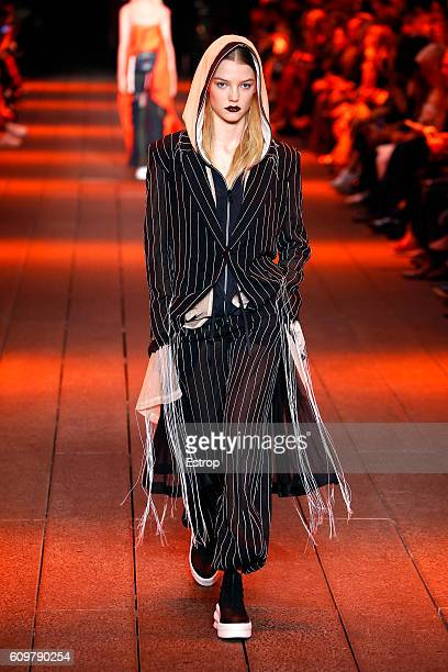 A model walks the runway at the DKNY Women's designed by DaoYi Chow Maxwell Osborne show at High Line on September 12 2016 in New York City