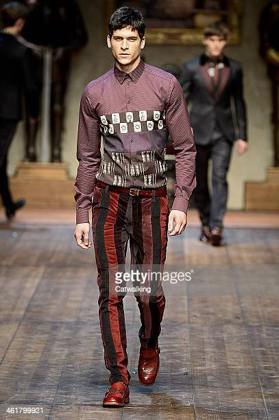 A model walks the runway at the Dolce and Gabbana Autumn Winter 2014 fashion show during Milan Menswear Fashion Week on January 11 2014 in Milan Italy