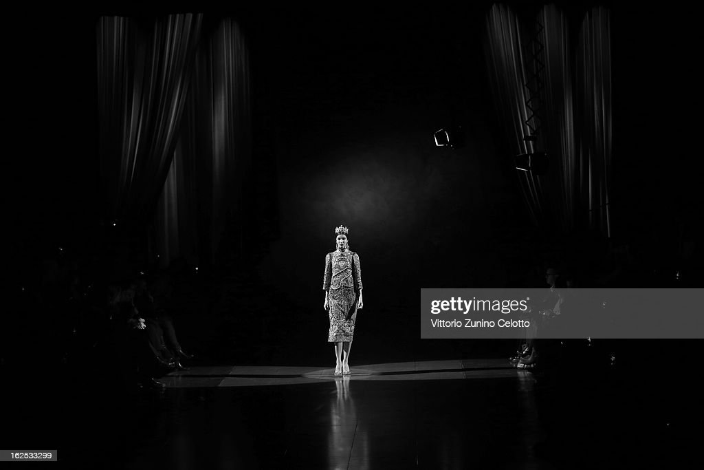 A model walks the runway at the Dolce e Gabbana fashion show as part of Milan Fashion Week Womenswear Fall/Winter 2013/14 on February 24, 2013 in Milan, Italy.