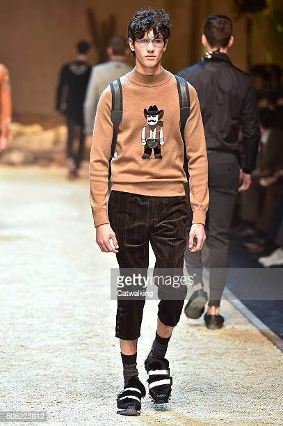 A model walks the runway at the Dolce Gabbana Autumn Winter 2016 fashion show during Milan Menswear Fashion Week on January 16 2016 in Milan Italy