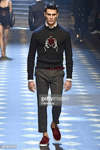 A model walks the runway at the Dolce Gabbana Autumn Winter 2017 fashion show during Milan Menswear Fashion Week on January 14 2017 in Milan Italy
