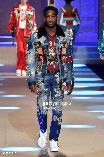 A model walks the runway at the Dolce Gabbana Autumn Winter 2018 fashion show during Milan Menswear Fashion Week on January 13 2018 in Milan Italy