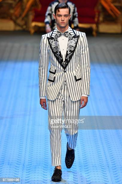 A model walks the runway at the Dolce Gabbana fashion show during Milan Men's Fashion Week Spring/Summer 2019 on June 16 2018 in Milan Italy