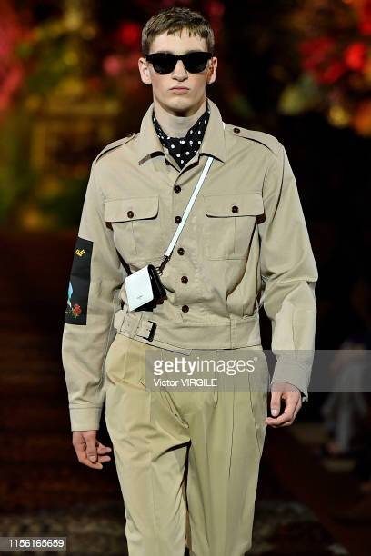 A model walks the runway at the Dolce Gabbana fashion show during the Milan Men's Fashion Week Spring/Summer 2020 on June 15 2019 in Milan Italy