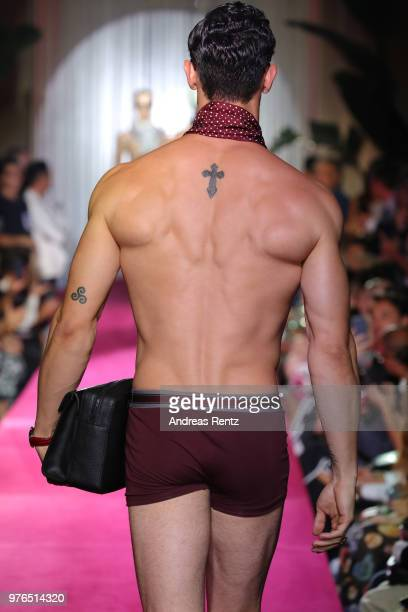A model walks the runway at the Dolce Gabbana Naked King Secret Show show during Milan Men's Fashion Week Spring/Summer 2019 on June 16 2018 in Milan...