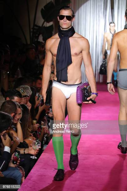 A model walks the runway at the Dolce Gabbana Naked King Secret Show show during Milan Men's Fashion Week Spring/Summer 2019 on June 16 2018 in Milan...