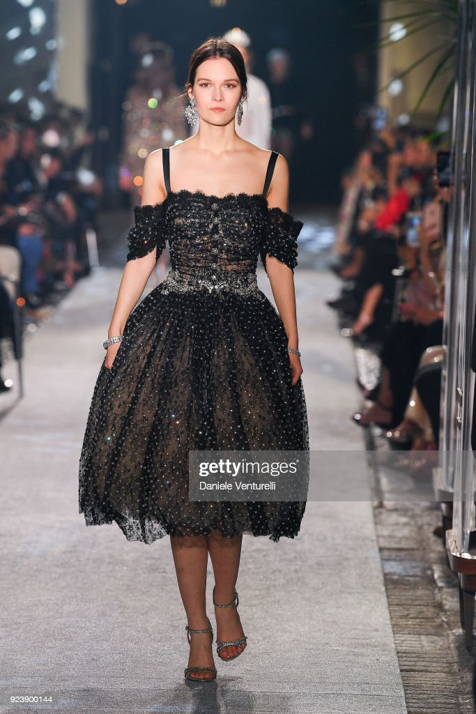 A model walks the runway at the Dolce & Gabbana Ready to