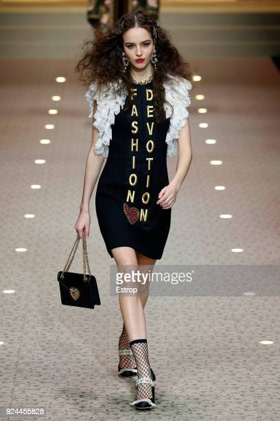 A model walks the runway at the Dolce Gabbana show during Milan Fashion Week Fall/Winter 2018/19 on February 25 2018 in Milan Italy