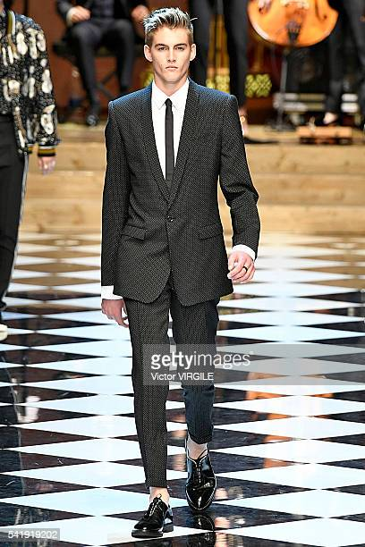 A model walks the runway at the Dolce Gabbana show during Milan Men's Fashion Week Spring/Summer 2017 on June 18 2016 in Milan Italy