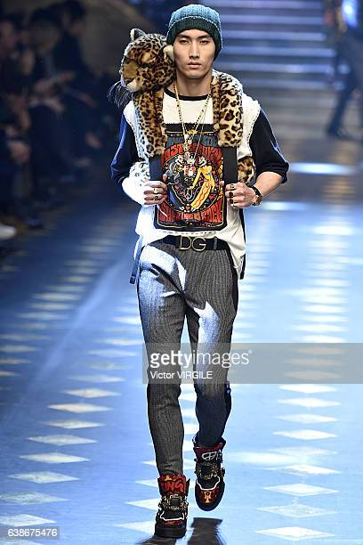 A model walks the runway at the Dolce Gabbana show during Milan Men's Fashion Week Fall/Winter 2017/18 on January 14 2017 in Milan Italy