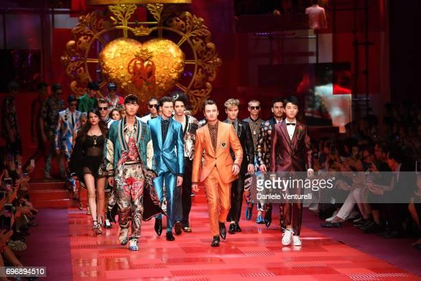 Model walks the runway at the Dolce Gabbana show during Milan Men's Fashion Week Spring/Summer 2018 on June 17 2017 in Milan Italy