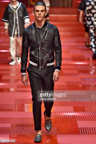 A model walks the runway at the Dolce Gabbana show during Milan Men's Fashion Week Spring/Summer 2018 on June 17 2017 in Milan Italy
