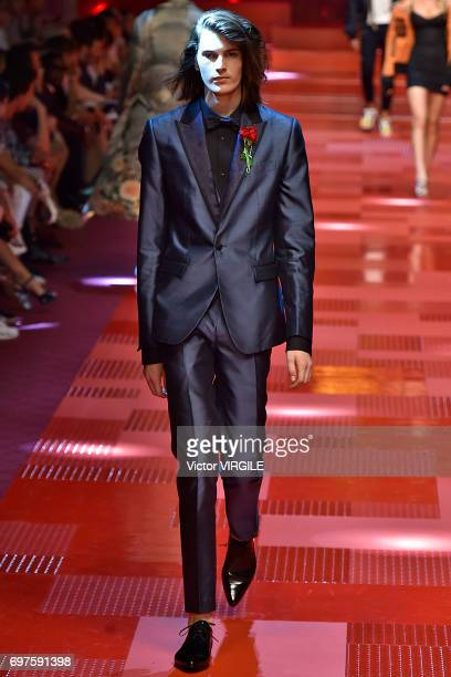 Model walks the runway at the Dolce & Gabbana show during Milan Men's Fashion Week Spring/Summer 2018 on June 17, 2017 in Milan, Italy.