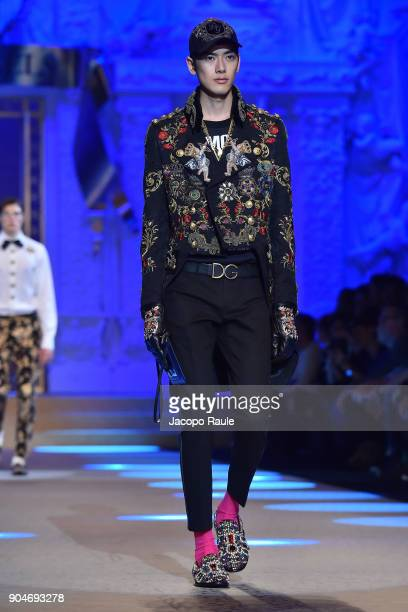 A model walks the runway at the Dolce Gabbana show during Milan Men's Fashion Week Fall/Winter 2018/19 on January 13 2018 in Milan Italy