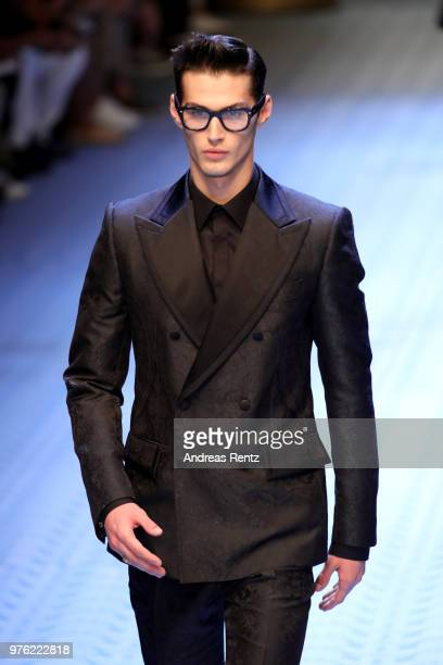 A model walks the runway at the Dolce Gabbana show during Milan Men's Fashion Week Spring/Summer 2019 on June 16 2018 in Milan Italy