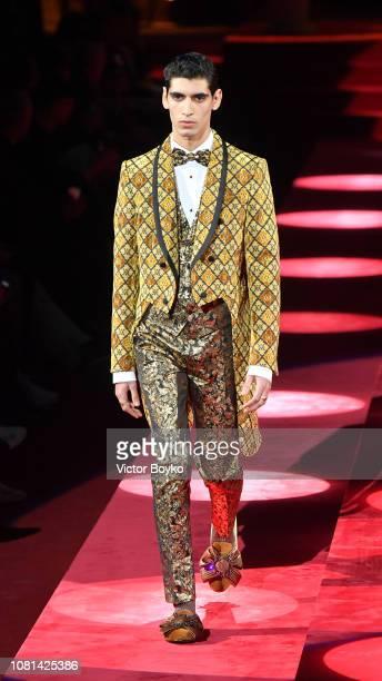 A model walks the runway at the Dolce Gabbana show during Milan Menswear Fashion Week Autumn/Winter 2019/20 at Metropol on January 12 2019 in Milan...