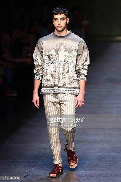 A model walks the runway at the Dolce Gabbana show during Milan Menswear Fashion Week Spring Summer 2014 on June 22 2013 in Milan Italy