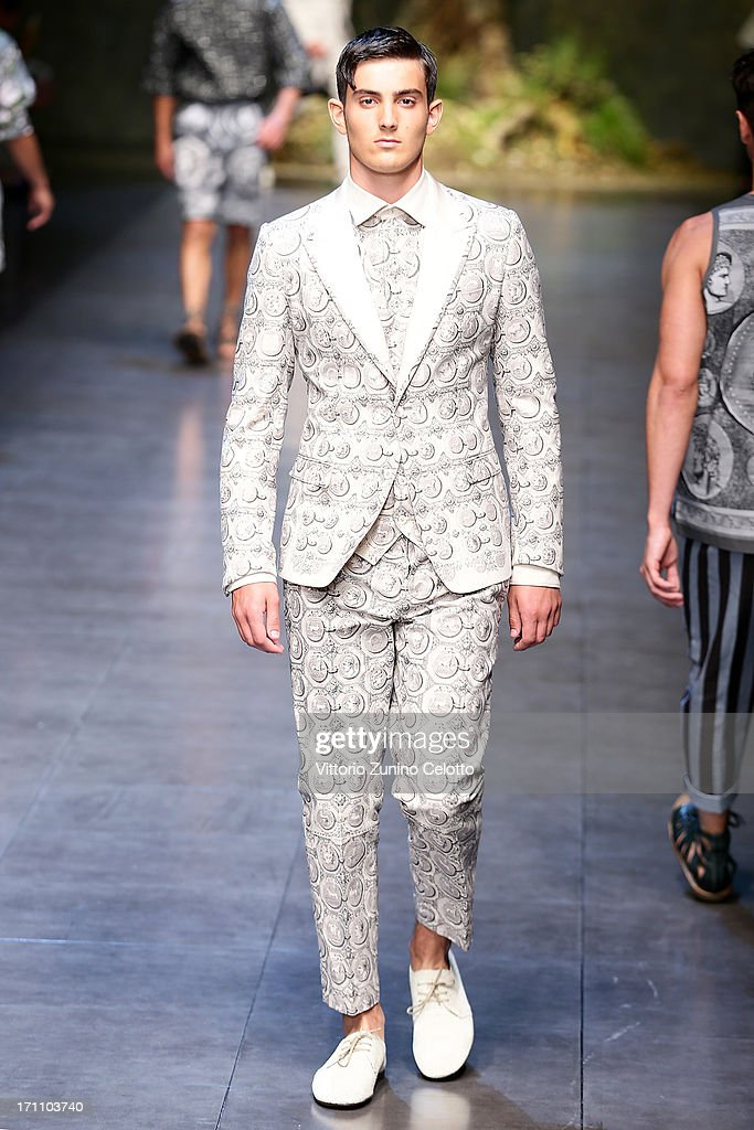 A model walks the runway at the Dolce & Gabbana show during Milan Menswear Fashion Week Spring Summer 2014 on June 22, 2013 in Milan, Italy.