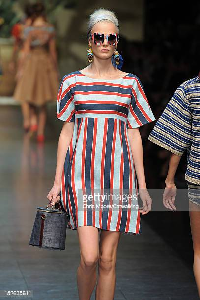A model walks the runway at the Dolce Gabbana Spring Summer 2013 fashion show during Milan Fashion Week on September 23 2012 in Milan Italy