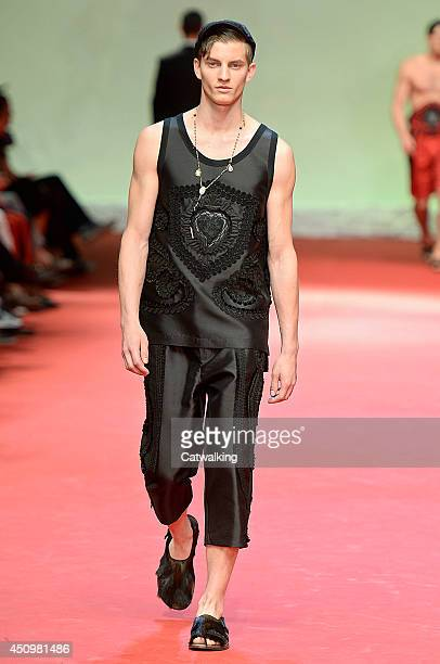A model walks the runway at the Dolce Gabbana Spring Summer 2015 fashion show during Milan Menswear Fashion Week on June 21 2014 in Milan Italy