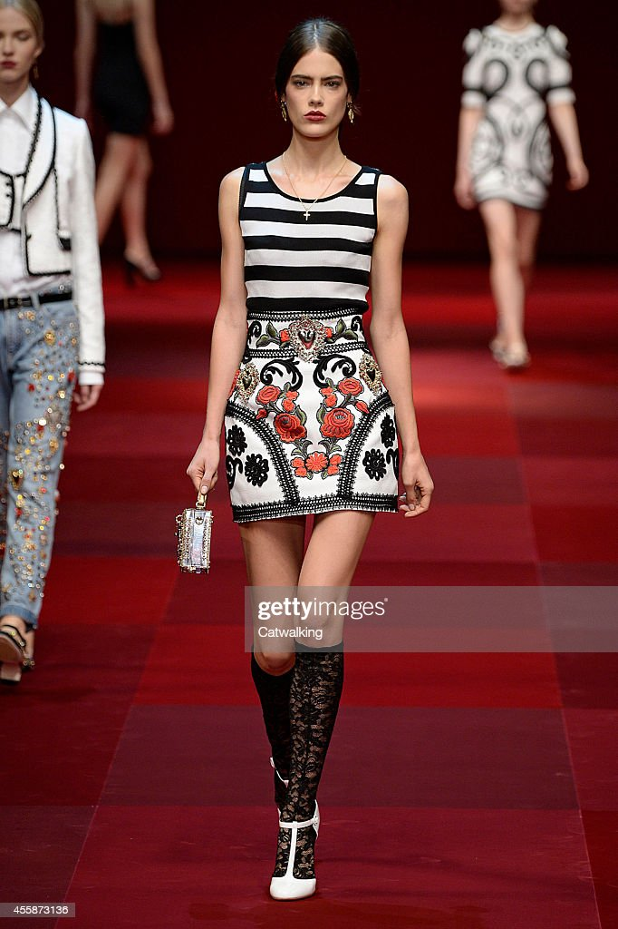A model, fashion detail, walks the runway at the Dolce