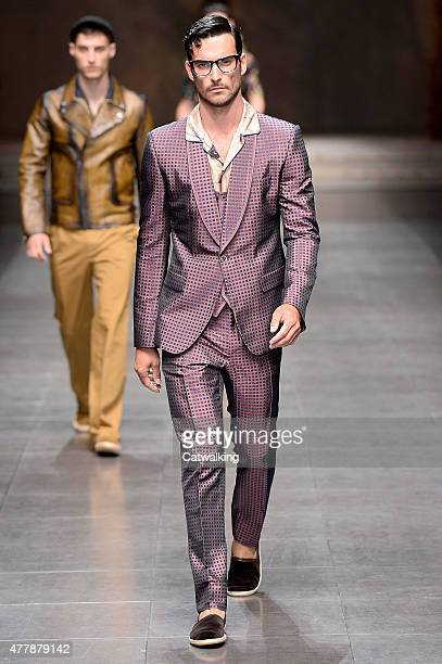 A model walks the runway at the Dolce Gabbana Spring Summer 2016 fashion show during Milan Menswear Fashion Week on June 20 2015 in Milan Italy
