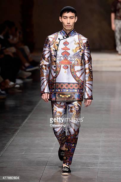 Model walks the runway at the Dolce & Gabbana Spring Summer 2016 fashion show during Milan Menswear Fashion Week on June 20, 2015 in Milan, Italy.