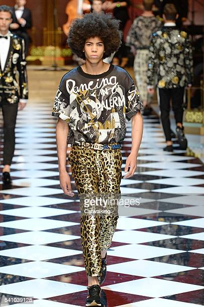 A model walks the runway at the Dolce Gabbana Spring Summer 2017 fashion show during Milan Menswear Fashion Week on June 18 2016 in Milan Italy