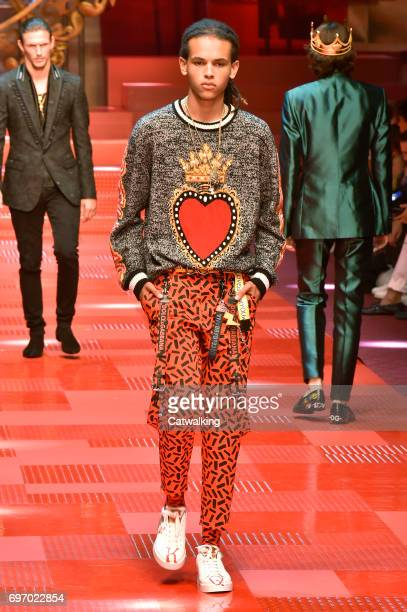 A model walks the runway at the Dolce Gabbana Spring Summer 2018 fashion show during Milan Menswear Fashion Week on June 17 2017 in Milan Italy