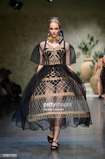 Model walks the runway at the Dolce & Gabbana Spring/Summer 2013 fashion show as part of Milan Womenswear Fashion Week on September 23, 2012 in...