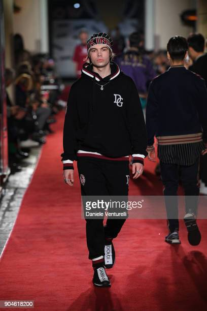 A model walks the runway at the Dolce Gabbana Unexpected Show during Milan Men's Fashion Week Fall/Winter 2018/19 on January 13 2018 in Milan Italy