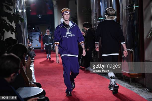 A model walks the runway at the Dolce Gabbana Unexpected Show show during Milan Men's Fashion Week Fall/Winter 2018/19 on January 13 2018 in Milan...