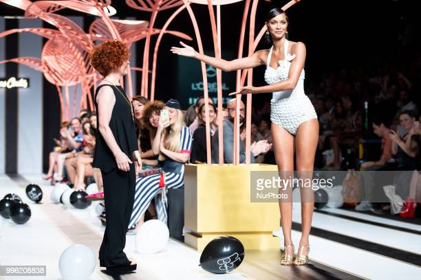 A model walks the runway at the 'Dolores Cortes' catwalk during the MercedesBenz Madrid Fashion Week Spring/Summer in Madrid Spain July 10 2018