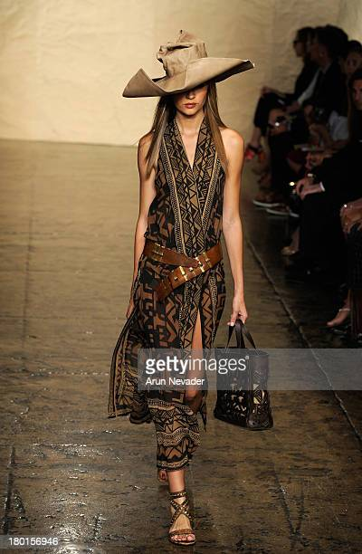 A model walks the runway at the Donna Karan New York fashion show during MercedesBenz Fashion Week Spring 2014 on September 9 2013 in New York City