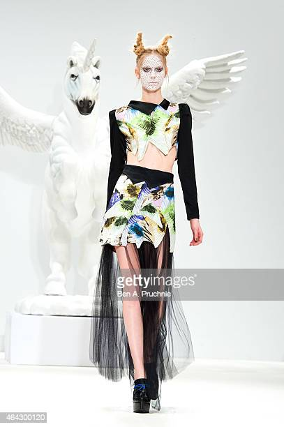 A model walks the runway at the Dora Abodi show during London Fashion Week Fall/Winter 2015/16 at Fashion Scout Venue on February 23 2015 in London...