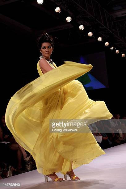 A model walks the runway at the Drashta Sarvaiya show at The Lakme Fashion Week Winter/Festive 2012 day 2 at the Grand Hyatt on August 4 2012 in...