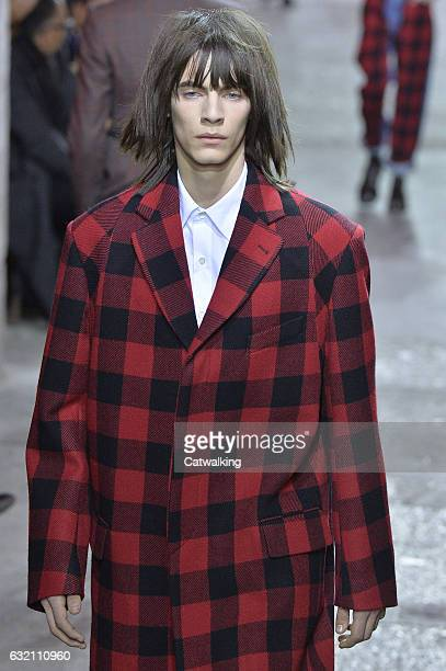 A model walks the runway at the Dries Van Noten Autumn Winter 2017 fashion show during Paris Menswear Fashion Week on January 19 2017 in Paris France