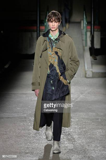 A model walks the runway at the Dries Van Noten Autumn Winter 2018 fashion show during Paris Menswear Fashion Week on January 18 2018 in Paris France