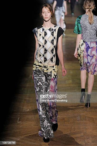 A model walks the runway at the Dries Van Noten fashion show during Paris Fashion Week on March 2 2011 in Paris France