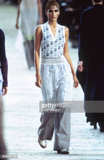 A model walks the runway at the Dries Van Noten Ready to Wear Spring/Summer 1997 fashion show during the Paris Fashion Week in October 1996 in Paris...