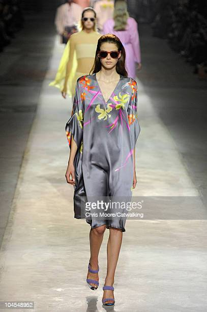A model walks the runway at the Dries Van Noten Spring Summer 2011 fashion show during Paris Fashion Week on September 29 2010 in Paris City