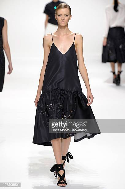 A model walks the runway at the Dries Van Noten Spring Summer 2012 fashion show during Paris Fashion Week on September 28 2011 in Paris France