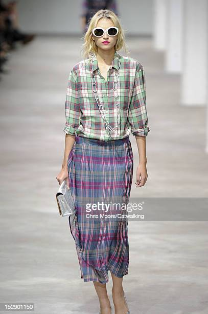 A model walks the runway at the Dries Van Noten Spring Summer 2013 fashion show during Paris Fashion Week on September 26 2012 in Paris France