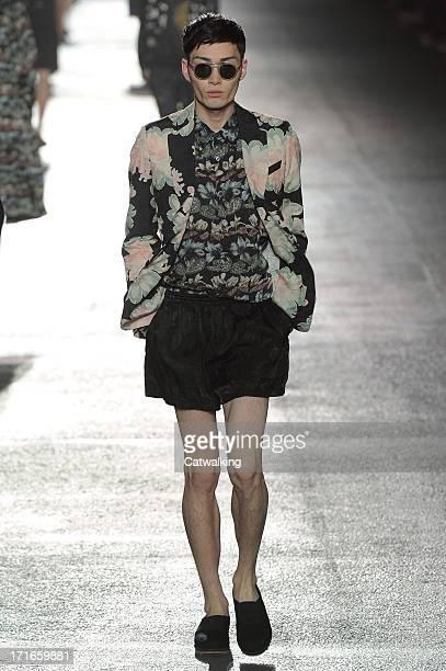 A model walks the runway at the Dries Van Noten Spring Summer 2014 fashion show during Paris Menswear Fashion Week on June 27 2013 in Paris France