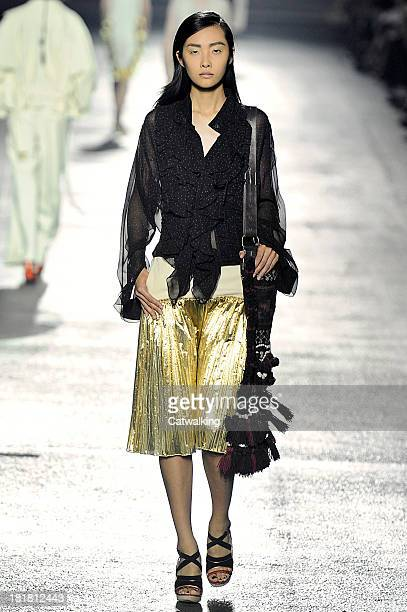 A model walks the runway at the Dries Van Noten Spring Summer 2014 fashion show during Paris Fashion Week on September 25 2013 in Paris France