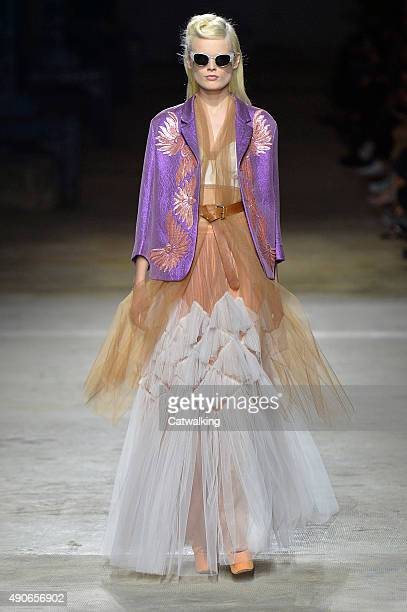 A model walks the runway at the Dries Van Noten Spring Summer 2016 fashion show during Paris Fashion Week on September 30 2015 in Paris France