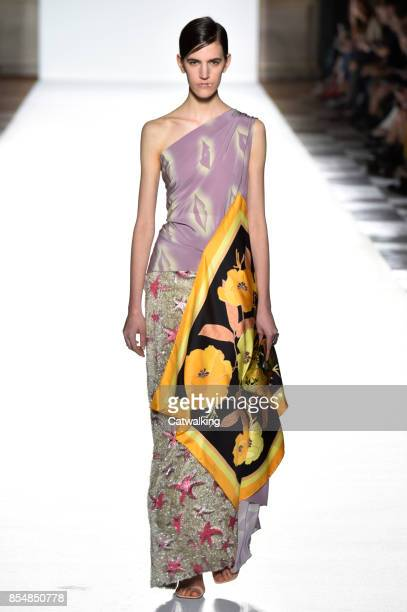 A model walks the runway at the Dries Van Noten Spring Summer 2018 fashion show during Paris Fashion Week on September 27 2017 in Paris France