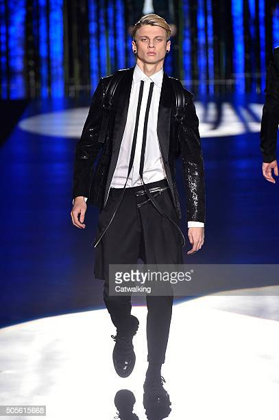 A model walks the runway at the DSquared2 Autumn Winter 2016 fashion show during Milan Menswear Fashion Week on January 19 2016 in Milan Italy