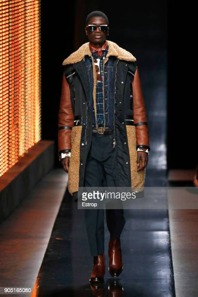 A model walks the runway at the Dsquared2 show during Milan Men's Fashion Week Fall/Winter 2018/19 on January 14 2018 in Milan Italy