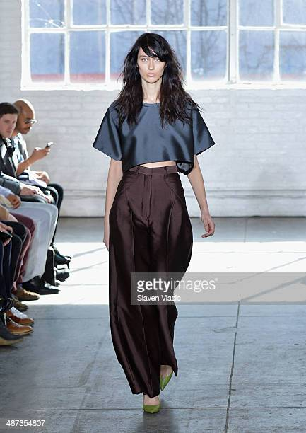 A model walks the runway at the Duckie Brown fashion show during MercedesBenz Fashion Week Fall 2014 at Industria Superstudio on February 6 2014 in...